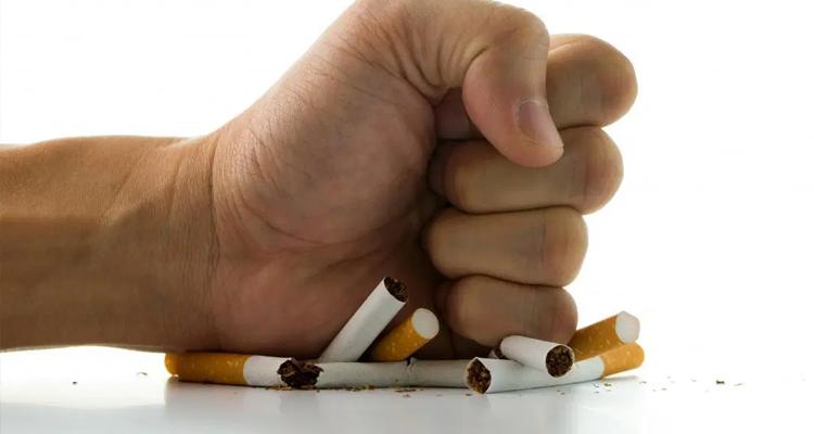 mão esmagando cigarros - imunidade